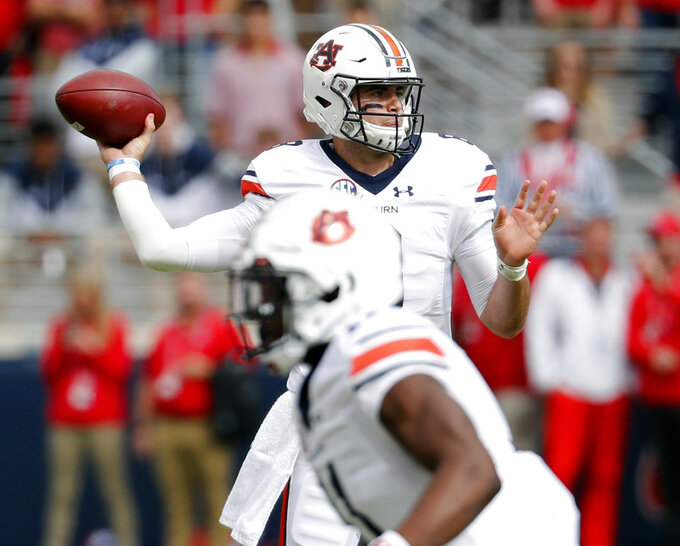 Auburn quarterback Jarrett Stidham (8) passes against Mississippi during the first half of an NCAA college football game on Saturday, Oct. 20, 2018, in Oxford, Miss. Auburn won 31-16. (AP Photo/Rogelio V. Solis)