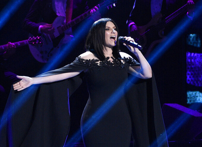"""FILE - Laura Pausini performs """"Lado Derecho del Corazon"""" at the 17th annual Latin Grammy Awards in Las Vegas on Nov. 17, 2016. Pausini will perform the Oscar nominated song """"Io Si,"""" (Seen) which she co-wrote with Diane Warren for the film """"The Life Ahead."""" The Oscars will be broadcast on Sunday. (Photo by Chris Pizzello/Invision/AP, File)"""
