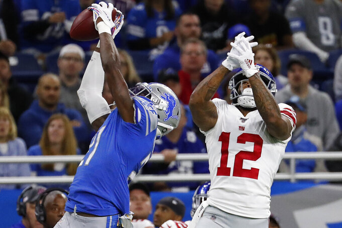 Detroit Lions defensive back Tracy Walker (21) intercepts a pass intended for New York Giants wide receiver Cody Latimer (12) during the first half of an NFL football game, Sunday, Oct. 27, 2019, in Detroit. (AP Photo/Rick Osentoski)