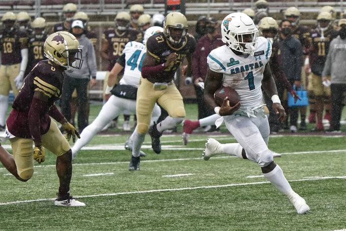 Coastal Carolina's CJ Marable (1) runs for a touchdown against Texas State during the second half of an NCAA college football game in San Marcos, Texas, Saturday, Nov. 28, 2020. (AP Photo/Chuck Burton)