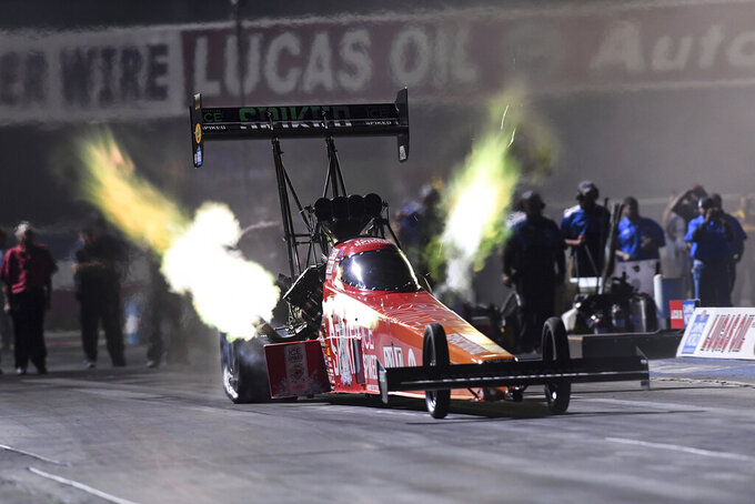 In this photo provided by the NHRA, Leah Pruett drives in Top Fuel qualifying Friday night, July 30, 2021, at the Lucas Oil NHRA Winternationals drag races at Auto Club Raceway in Pomona, Calif. (Jerry Foss/NHRA via AP)