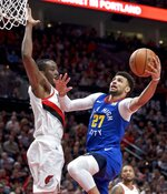 Denver Nuggets guard Jamal Murray, right, shoots as Portland Trail Blazers forward Al-Farouq Aminu defends during the first half of Game 3 of an NBA basketball second-round playoff series Friday, May 3, 2019, in Portland, Ore. (AP Photo/Craig Mitchelldyer)