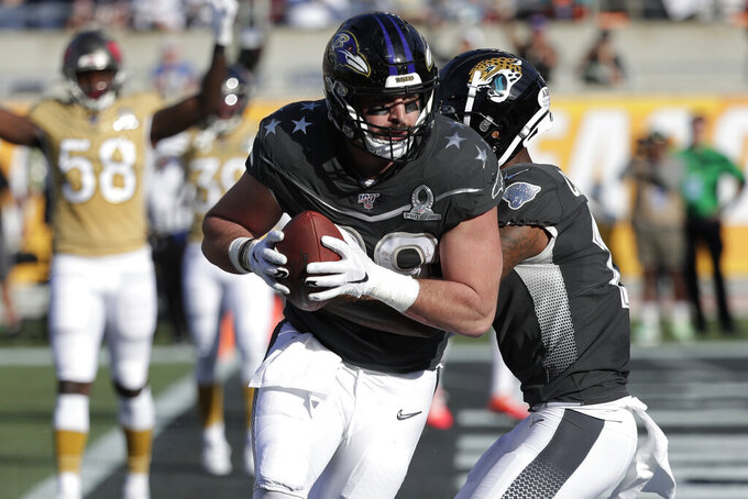 AFC tight end Mark Andrews, of the Baltimore Ravens, (89) scores a touchdown, during the first half of the NFL Pro Bowl football game against the NFC, Sunday, Jan. 26, 2020, in Orlando, Fla. (AP Photo/John Raoux)
