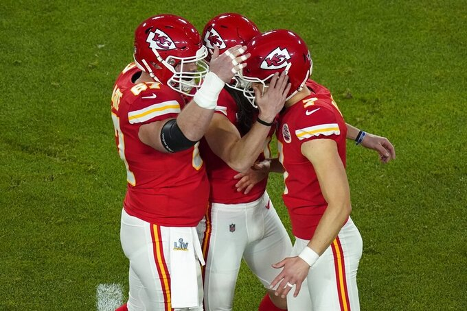 Kansas City Chiefs kicker Harrison Butker (7) is congratulated after kicking a 49-yard field goal during the first half of the NFL Super Bowl 55 football game against the Tampa Bay Buccaneers Sunday, Feb. 7, 2021, in Tampa, Fla. (AP Photo/Charlie Riedel)