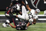 Atlanta Falcons cornerback A.J. Terrell (24) hits Las Vegas Raiders running back Devontae Booker (23) during the second half of an NFL football game, Sunday, Nov. 29, 2020, in Atlanta. (AP Photo/Brynn Anderson)