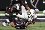 Atlanta Falcons cornerback A.J. Terrell (24) hits Las Vegas Raiders running back Devontae Booker (23) during the second half of an NFL football game, Sunday, Nov. 29, 2020, in Atlanta. (AP Photo/Brynn Anderson)
