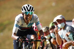Colombia's Egan Bernal crosses the finish line of the stage 13 of the Tour de France cycling race over 191 kilometers from Chatel-Guyon to Puy Mary, Friday, Sept. 11, 2020. (Benoit Tessier, Pool via AP)