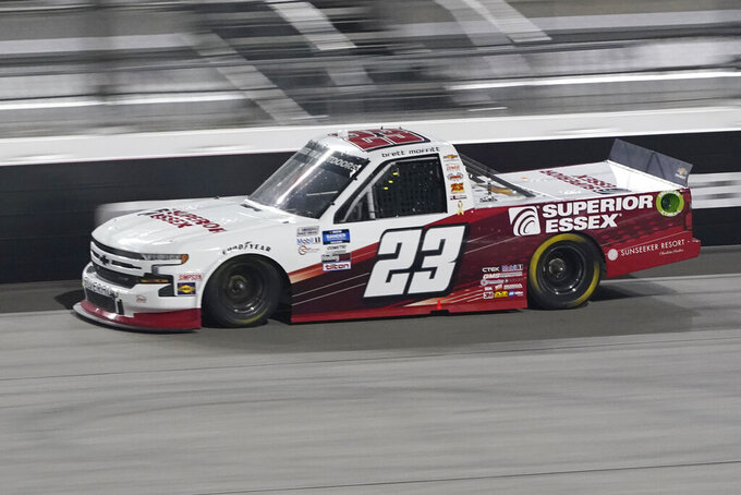 Brett Moffitt (23) drives into Turn 1 during a NASCAR Truck Series auto race Thursday, Sept. 10, 2020, in Richmond, Va. (AP Photo/Steve Helber)