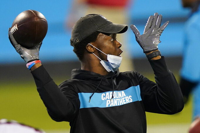 Carolina Panthers quarterback Teddy Bridgewater warms up before an NFL football game against the Atlanta Falcons Thursday, Oct. 29, 2020, in Charlotte, N.C.. (AP Photo/Gerry Broome)