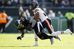 Philadelphia Eagles' DeSean Jackson, left, is tackled by Chicago Bears' Kyle Fuller during the first half of an NFL football game, Sunday, Nov. 3, 2019, in Philadelphia. (AP Photo/Matt Rourke)