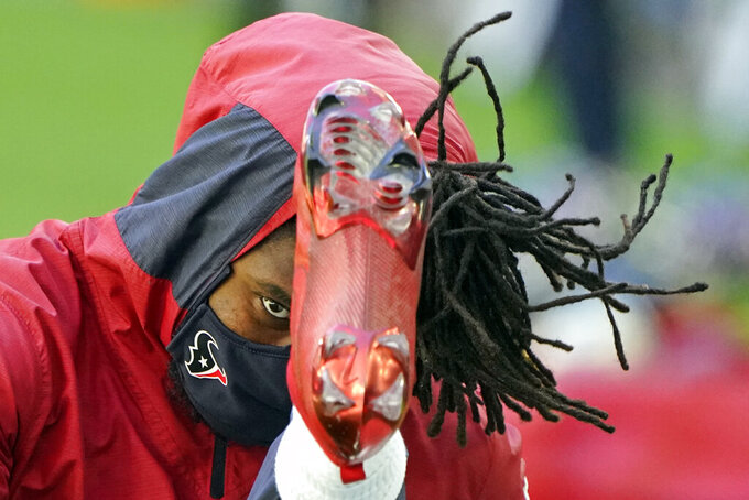 Houston Texans running back Buddy Howell stretches before an NFL football game against the Tennessee Titans Sunday, Jan. 3, 2021, in Houston. (AP Photo/Eric Christian Smith)