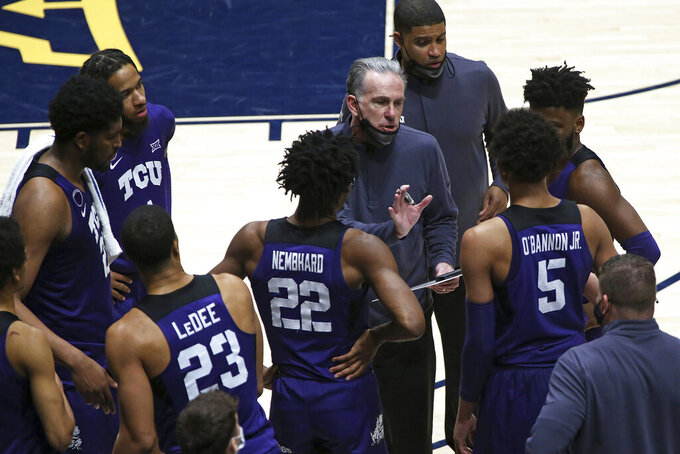 Texas Christian coach Jamie Dixon speaks with players during the second half of an NCAA college basketball game against West Virginia Thursday, March 4, 2021, in Morgantown, W.Va. (AP Photo/Kathleen Batten)