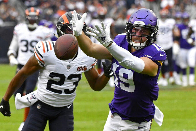 Minnesota Vikings wide receiver Adam Thielen, right, misses a pass as Chicago Bears cornerback Kyle Fuller (23) defends during the first half of an NFL football game Sunday, Sept. 29, 2019, in Chicago. (AP Photo/Matt Marton)