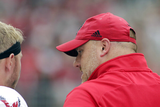 Eastern Washington head coach Aaron Best, right, speaks with quarterback Gage Gubrud during the first half of an NCAA college football game against Washington State in Pullman, Wash., Saturday, Sept. 15, 2018. (AP Photo/Young Kwak)