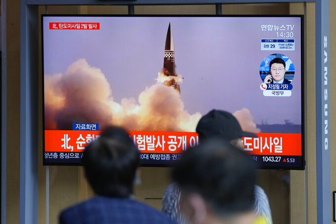 People watch a TV screen showing a news program reporting about North Korea's missiles with file image, in Seoul, South Korea, Wednesday, Sept. 15, 2021. North Korea fired two ballistic missiles into waters off its eastern coast Wednesday afternoon, two days after claiming to have tested a newly developed missile in a resumption of its weapons displays after a six-month lull. (AP Photo/Lee Jin-man)