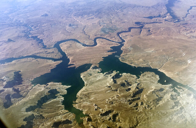 FILE - In this Sept. 11, 2019, file photo, is an aerial view of Lake Powell on the Colorado River along the Arizona-Utah border. A set of guidelines for managing the Colorado River helped several states through a dry spell, but it's not enough to keep key reservoirs in the American West from plummeting amid persistent drought and climate change, according to a U.S. report released Friday, Dec. 18, 2020. (AP Photo/John Antczak, File)