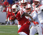 Louisville running back Hassan Hall (19) is pursued by North Carolina State defensive back Tanner Ingle (10) during the first half of an NCAA college football game, in Louisville, Ky., Saturday, Nov. 17, 2018. (AP Photo/Timothy D. Easley)