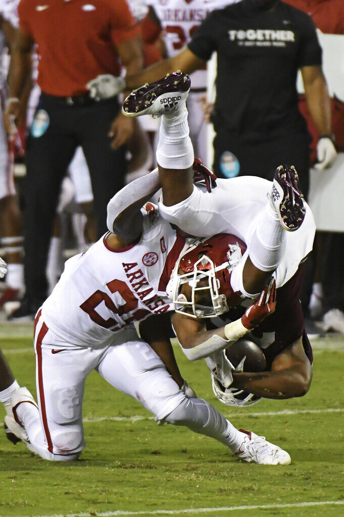 Arkansas defensive back Montaric Brown (21) tackles Mississippi State running back Dillon Johnson during the first half of an NCAA college football game in Starkville, Miss., Saturday, Oct. 3, 2020. (AP Photo/Thomas Graning)