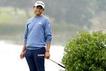 Collin Morikawa reacts after missing a putt on the 18th hole during the third round of the PGA Championship golf tournament at TPC Harding Park Saturday, Aug. 8, 2020, in San Francisco. (AP Photo/Charlie Riedel)