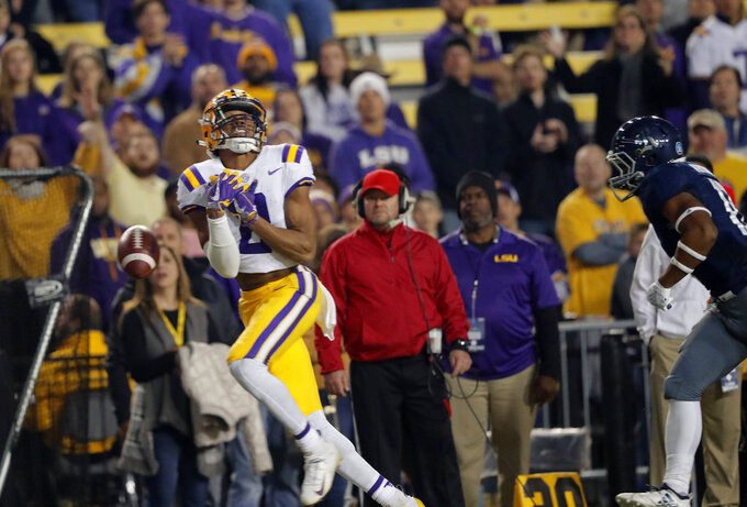 LSU wide receiver Justin Jefferson (2) drops a long pass near the end zone as Rice cornerback Collin Whitaker pursues in the first half of an NCAA college football game in Baton Rouge, La., Saturday, Nov. 17, 2018. (AP Photo/Gerald Herbert)