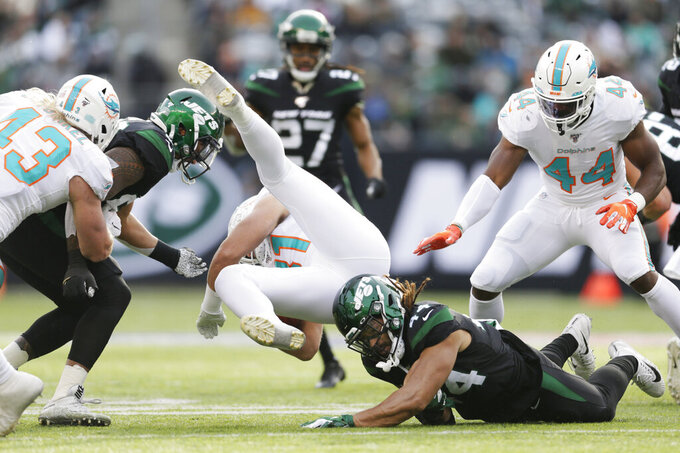 Miami Dolphins tight end Durham Smythe (81) is stopped during the first half of an NFL football game against the New York Jets, Sunday, Dec. 8, 2019, in East Rutherford, N.J. (AP Photo/Adam Hunger)
