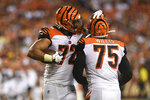 Cincinnati Bengals defensive end Kerry Wynn (72) celebrates with defensive end Jordan Willis (75) after the Bengals recovered a Washington Redskins fumble during the third quarter of an NFL preseason football game in Landover, Md., Thursday, Aug. 15, 2019. The Bengals won 23-13. (AP Photo/Susan Walsh)