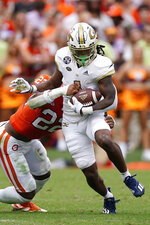 Georgia Tech running back Jahmyr Gibbs (1) is brought down by Clemson linebacker Trenton Simpson (22) in the first half of an NCAA college football game Saturday, Sept. 18, 2021, in Clemson, S.C. (AP Photo/John Bazemore)