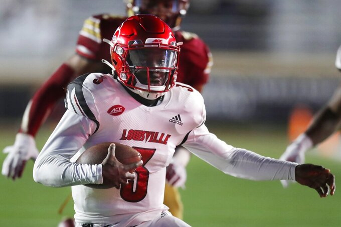 Louisville quarterback Malik Cunningham (3) carries the ball during the first half of an NCAA college football game against Boston College, Saturday, Nov. 28, 2020, in Boston. (AP Photo/Michael Dwyer)