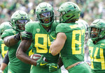Oregon tight end Kano Dillon (85) celebrates a touchdown with Oregon tight end Ryan Bay (87) against Portland State in the second quarter during an NCAA college football game in Eugene, Ore., Saturday, Sept. 8, 2018. (AP Photo/Thomas Boyd)