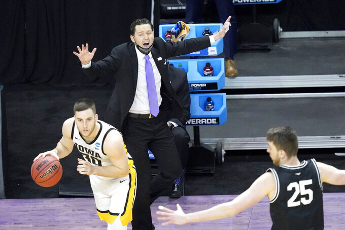 Grand Canyon head coach Bryce Drew directs his team during the first half of a first round NCAA college basketball tournament game Saturday, March 20, 2021, at the Indiana Farmers Coliseum in Indianapolis. (AP Photo/Charles Rex Arbogast)