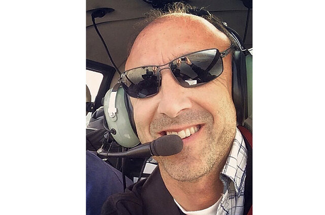 This undated photo provided by Group 3 Aviation shows helicopter pilot Ara Zobayan, who was at the controls of the helicopter that crashed in Southern California, Sunday, Jan. 26, 2020, killing all nine aboard including former Lakers star Kobe Bryant. (Group 3 Aviation via AP)