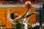 Baylor forward NaLyssa Smith (1) shoots in front of Oklahoma State center Kassidy De Lapp, rear, during the first half of an NCAA college basketball game Wednesday, Jan. 20, 2021, in Stillwater, Okla. (AP Photo/Sue Ogrocki)