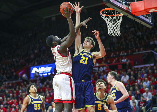 Rutgers  forward Akwasi Yeboah (1) shoots as Michigan guard Franz Wagner (21) defends during the first half of an NCAA college basketball game, Wednesday, Feb. 19, 2020 in Piscataway, N.J. (Andrew Mills/NJ Advance Media via AP)