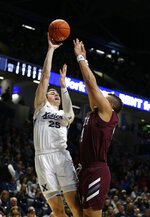 Xavier forward Jason Carter (25) shoots over Missouri State forward Gaige Prim, right, during the first half of an NCAA college basketball game, Friday, Nov. 15, 2019, in Cincinnati. (AP Photo/Gary Landers)