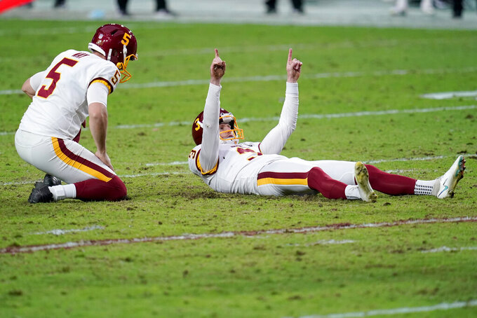 Washington Football Team kicker Dustin Hopkins (3) celebrates his point after during the first half of an NFL football game against the San Francisco 49ers, Sunday, Dec. 13, 2020, in Glendale, Ariz. (AP Photo/Ross D. Franklin)