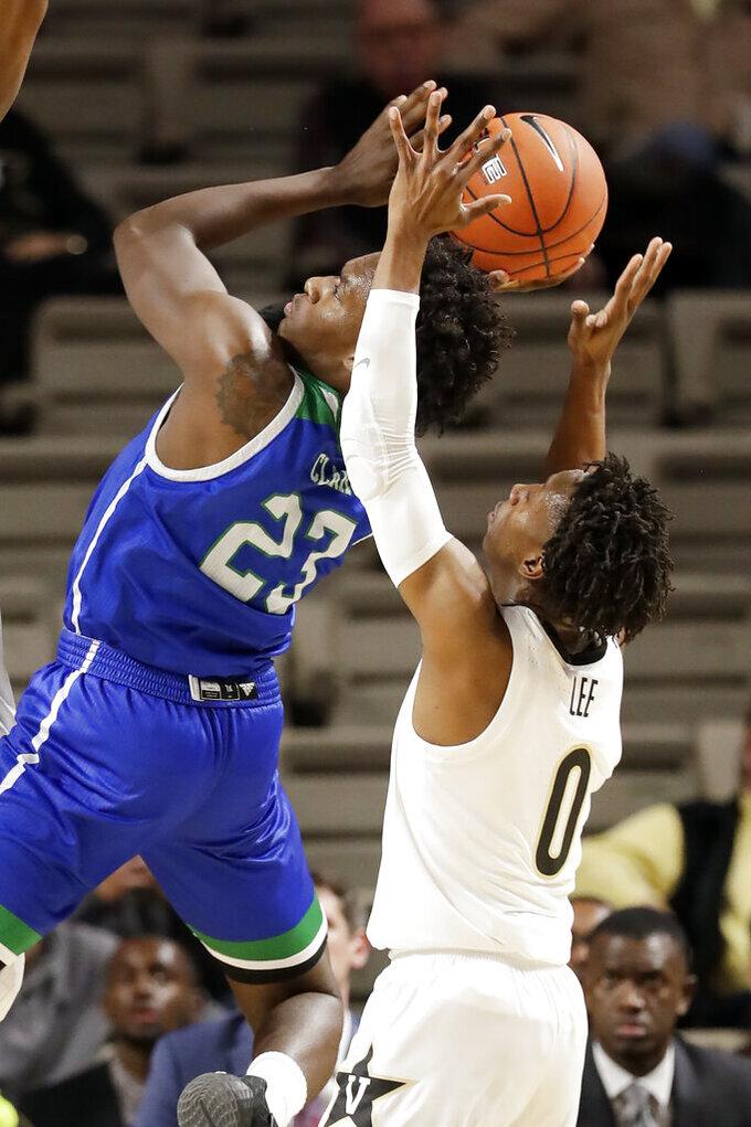 Texas A&M-Corpus Christi guard Jalon Clark (23) shoots in front of Vanderbilt guard Saben Lee (0) in the first half of an NCAA college basketball game Monday, Nov. 11, 2019, in Nashville, Tenn. (AP Photo/Mark Humphrey)