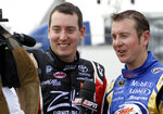 FILE - In this May 7, 2010, file photo, drivers Kyle Busch, left, and Kurt Busch speak to reporters during practice for a NASCAR Sprint Cup Series auto race in Darlington, S.C.  The Busch brothers are moving up on the Allisons on NASCAR's all-time wins list for siblings. (AP Photo/Gerry Broome, File)