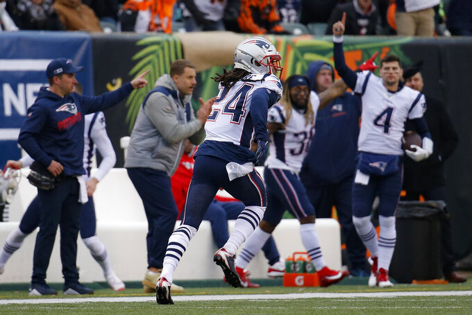 New England Patriots cornerback Stephon Gilmore (24) runs in a touchdown off an interception in the second half of an NFL football game against the Cincinnati Bengals, Sunday, Dec. 15, 2019, in Cincinnati. (AP Photo/Frank Victores)