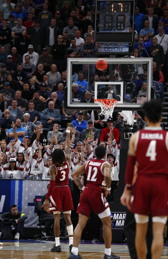New Mexico State guard Terrell Brown (3) shoots a foul shot against Auburn in the second half during a first round men's college basketball game in the NCAA Tournament, Thursday, March 21, 2019, in Salt Lake City. (AP Photo/Jeff Swinger)