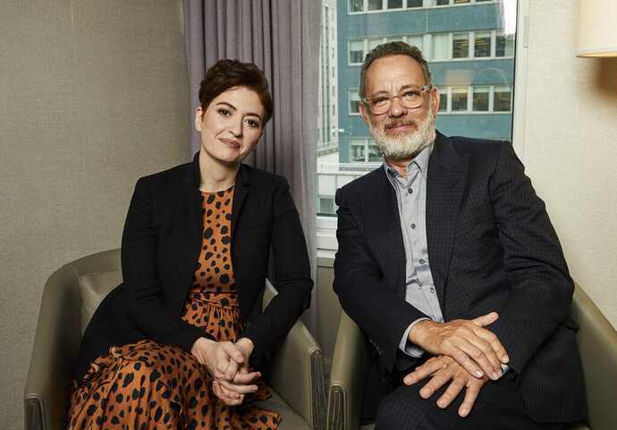This Nov. 17, 2019 photo shows Marielle Heller, left, and Tom Hanks pose for a portrait in New York to promote their film,