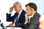 President Joe Biden talks with French President Emmanuel Macron during the final session of the G-7 summit in Carbis Bay, England, Sunday, June 13, 2021. (Doug Mills/The New York Times via AP, Pool)
