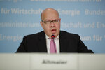 German Economy Minister Peter Altmaier briefs the media about a so called 'stabilization package' for German airline Lufthansa at the economy ministry in Berlin, Germany, Monday, May 26, 2020. (AP Photo/Markus Schreiber, Pool)