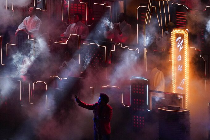 The Weeknd performs during the halftime show at the NFL Super Bowl 55 football game between the Kansas City Chiefs and Tampa Bay Buccaneers, Sunday, Feb. 7, 2021, in Tampa, Fla. (AP Photo/Charlie Riedel)