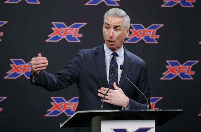 "FILE - In this Feb. 25, 2019, file photo, XFL Commissioner Oliver Luck gestures during a press conference in Seattle.  When the XFL debuts in February, it will take a ""Star Trek"" approach of going where no football league has gone before. (AP Photo/Ted S. Warren, File)"