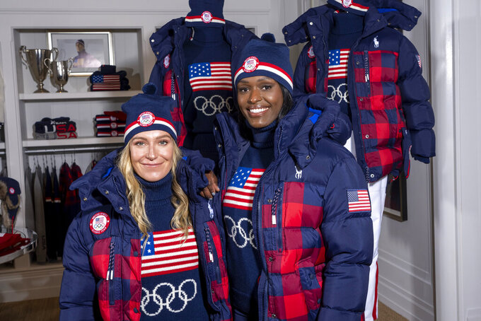 Snowboarder Jamie Anderson, left, and bobsledder Aja Evans model the Team USA Beijing winter Olympics closing ceremony uniforms designed by Ralph Lauren on Wednesday, Oct. 27, 2021, in New York. (Photo by Charles Sykes/Invision/AP)