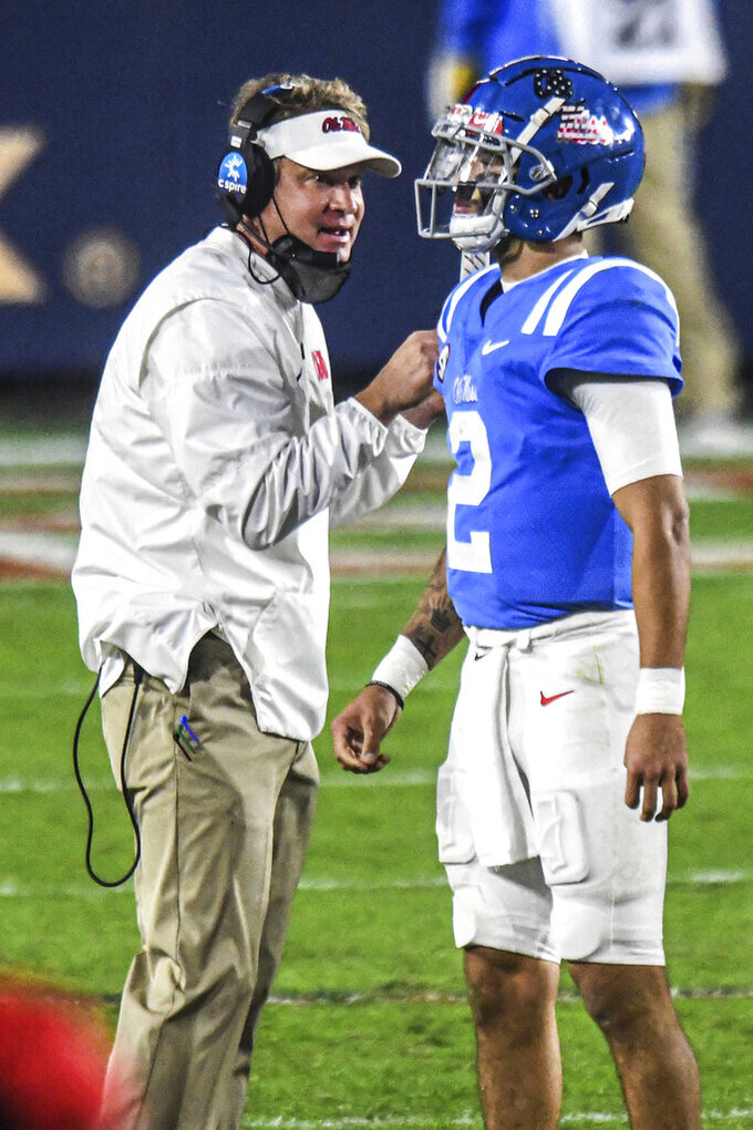 Mississippi coach Lane Kiffin talks with quarterback Matt Corral (2) durng the second half of the team's NCAA college football game against South Carolina in Oxford, Miss., Saturday, Nov. 14, 2020. (AP Photo/Bruce Newman)