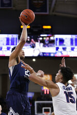 BYU forward Yoeli Childs, left, shoots over Gonzaga forward Brandon Clarke during the first half of an NCAA college basketball game in Spokane, Wash., Saturday, Feb. 23, 2019. (AP Photo/Young Kwak)
