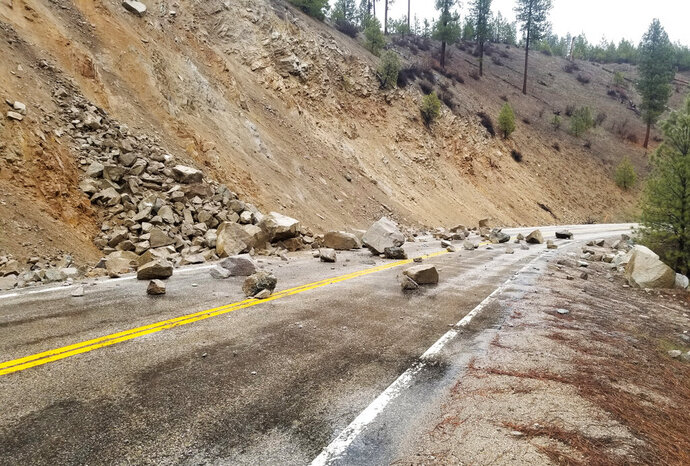 This photo provided by Tyler Beyer shows a rockslide on Highway 21 near Lowman, Idaho, after a magnitude 6.5 earthquake struck Tuesday, March 31, 2020. The earthquake struck north of Boise, Idaho, Tuesday evening, with people across a large area reporting shaking. (Tyler Beyer via AP)