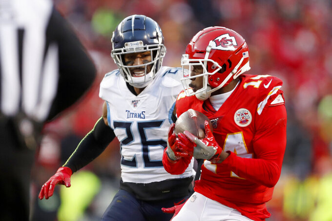 Kansas City Chiefs' Sammy Watkins (14) catches a touchdown pass in front of Tennessee Titans cornerback Logan Ryan (26) during the second half of the NFL AFC Championship football game against the Tennessee Titans Sunday, Jan. 19, 2020, in Kansas City, MO. (AP Photo/Jeff Roberson)