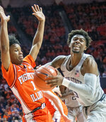 Penn State' guard Jamari Wheeler (5) shoots against Illinois guard Trent Frazier (1) during the second half of an NCAA college basketball game in Champaign, Ill., Saturday, Feb. 23, 2019.(AP Photo/Robin Scholz)
